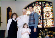 Christina with her dad, Mike and stepmother, Kim at the Christening of her stepsister, Sabrina
