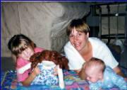 "Christina with her ""baby"" Sarah, and her babysitter Sarah and Sam 9/97"